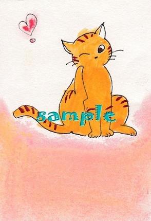 掻く仕草の猫